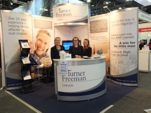 Turner Freeman booth at the TSANZSRS conference